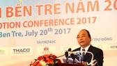 Thủ tướng Nguyễn Xuân Phúc phát biểu tại hội nghị. Ảnh: HÀM LUÔNG