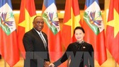 National Assembly Chairwoman Nguyen Thi Kim Ngan (R) and President of the Senate of Haiti Youri Latortue (Source: VNA)