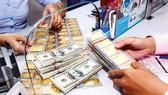 Huy động vàng và USD trong dân: Cần cơ chế mở sàn giao dịch