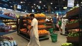 Customers are seen shopping at the al-Meera market in the Qatari capital Doha, on June 10, 2017.
