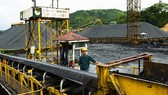 A worker of the Vietnam National Coal and Mineral Industries Group' controls a production line. — VNA/VNS Photo Minh Duc