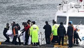 Rescue workers to resume search for two missing in capsizing of fishing boat