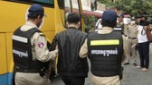 Cambodia arrests 100 Chinese suspects over telecoms fraud