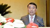 Thống đốc Ngân hàng Nhà nước Việt Nam Lê Minh Hưng trình bày Tờ trình. Ảnh: quochoi.vn