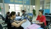 Nâng cao chất lượng công tác tuyên truyền, hỗ trợ người nộp thuế. (Ảnh: Hoàng Hùng/TTXVN)