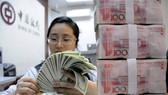 Trung Quốc: Đầu tư trực tiếp ra nước ngoài sụt giảm mạnh