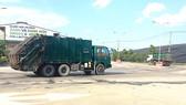 Xe vận chuyển rác về Khu liên hợp xử lý chất thải rắn Đa Phước     Ảnh: Kiều Phong