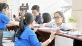 Khai thuế tại Cục Thuế TPHCM  Ảnh: CAO THĂNG