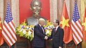 Chủ tịch nước Trần Đại Quang và Tổng thống Donald Trump. Ảnh: VGP