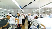 A hi-tech garment making line invested by Japanese Uniqlo Company in Vietnam (Photo: SGGP)
