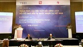 A view of the workshop on challenges of policy and regulatory changes for foreign investors in Vietnam in Hanoi on December 7 (Photo: SGGP)
