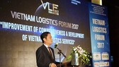 Minister of Industry and Trade Tran Tuan Anh states at Vietnam Logistics Forum 2017 opened in Hanoi on December 15 (Photo: SGGP)
