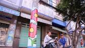 在電燈柱繪圖是為美化市容作出努力。