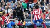 Real (đen) hạ quyết tâm lớn vượt qua Atletico. Ảnh: Getty Images