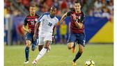 Mỹ (phải) giành được thắng lợi trước Martinique.