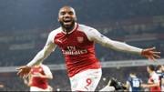 Alexandre Lacazette mừng cú đúp đầu tiên tại bóng đá Anh. Ảnh: Getty Images
