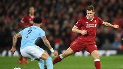 James Milner (phải) tin rằng tinh thần của Man.City sẽ không bị ảnh hưởng dù chia tay cúp châu Âu. Ảnh: Getty Images