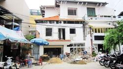 Xây dựng ảnh hưởng đến nhà lân cận phải ngừng thi công