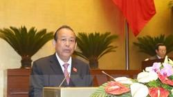 Phó Thủ tướng Thường trực Chính phủ Trương Hòa Bình trình bày Báo cáo.