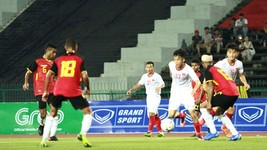 Vietnamese players (in white) in action (Photo: VNA)