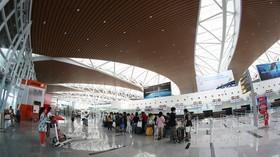 Passengers check-in at Da Nang International Airport's new terminal yesterday. (Photo: VNS)