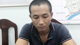 Viet gives himself to police (Photo: SGGP)