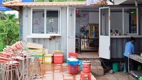 Peple convert container into kitchen (Photo: SGGP)