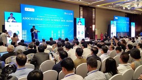 The Chairman of the Hanoi People's Committee Nguyen Duc Chung delivered his opening speech at the ASOCIO Summit. Photo by Tran Binh