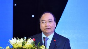 Vietnamese Prime Minister Nguyen Xuan Phuc speaks at the Binh Thuan Investment Promotion Conference