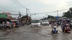 Downpour floods the city roads
