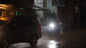 Torrential rain hits Ho Chi Minh City yesterday.