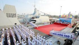 Flag-hoisting ceremony of missile escort warships