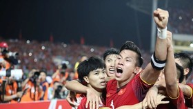Vietnamese red flag players are happy after 90 minute match