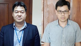 Nguyen Hoai Giang and Pham Xuan Quang who are arrested by the police. (Photo: SGGP)