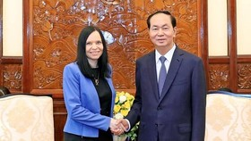 President Tran Dai Quang (R) receives the Ambassador of Poland Barbara Szymanowska on June 21st.( Photo: VNA )