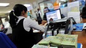 河內市稅務局日前公開153個拖欠稅款、手續費和土地租金單位的名冊,總額逾3043億1600萬元。(示意圖源:KT)
