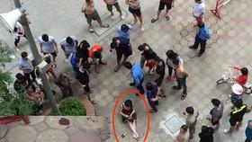 大圖中畫紅圈的是受傷的婦女;小圖為現場留下的兩枚彈殼。(圖源:法律報)