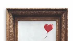 班克斯作品《女孩與氣球》。