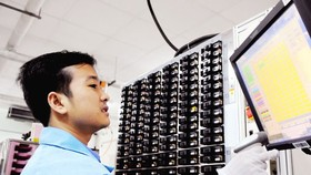 The man working for an US electronic firm in HCMC (Illustrative photo: SGGP)