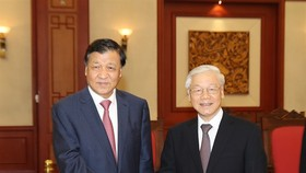 Party General Secretary Nguyen Phu Trong (right) yesterday held talks with Liu Yunshan, Politburo Standing Committee member and Secretary of the Secretariat of the Communist Party of China (CPC) Central Committee, during the latter's visit to Hanoi (Photo