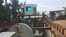 The smart pumping system has reduced flooding time in Nguyen Huu Canh street but it still needs more testing to prove efficiency (Photo: SGGP)