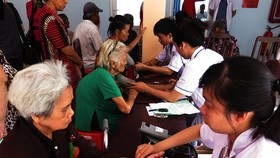 Senior citizens receive health checks in District 8, HCM City. (Photo: VNA/VNS)