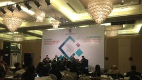Experts discuss industrial investment through M&A activities in Hanoi yesterday. (Photo: VNA/VNS)