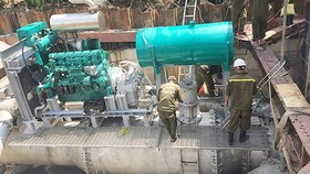 The pumping machine system in Nguyen Huu Canh street (Photo: SGGP)