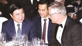 Chairman of HCMC People's Committee Nguyen Thanh Phong talks to Nicolas Audier, chairman of Eurocham (Photo: SGGP)