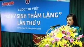 """Bộ trưởng Bộ Y tế Nguyễn Thị Kim Tiến phát biểu tại lễ phát động cuộc thi viết """"Sự hy sinh thầm lặng"""""""