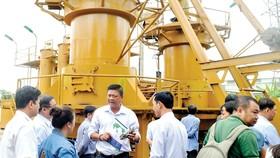 Hệ thống chuyển hóa rác thành khí chạy máy phát điện tại bãi rác Gò Cát. Ảnh: THÀNH TRÍ