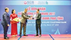 SCB nhận chứng chỉ pci dss lần 2 và giải thưởng thanh toán Xuất sắc từ ngân hàng Standard Chartered