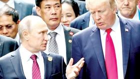 Tổng thống Nga Vladimir Putin và Tổng thống Mỹ  Donald Trump bên lề Hội nghị cấp cao APEC tại Đà Nẵng tháng 11-2017. Ảnh: Sputnik