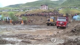 This image captured by footage from North Korea's state TV station on Sept. 16, 2016, shows North Korea's efforts to recover from massive floods that hit the country's northeastern province. (For Use Only in the Republic of Korea. No Redistribution) (Yonh